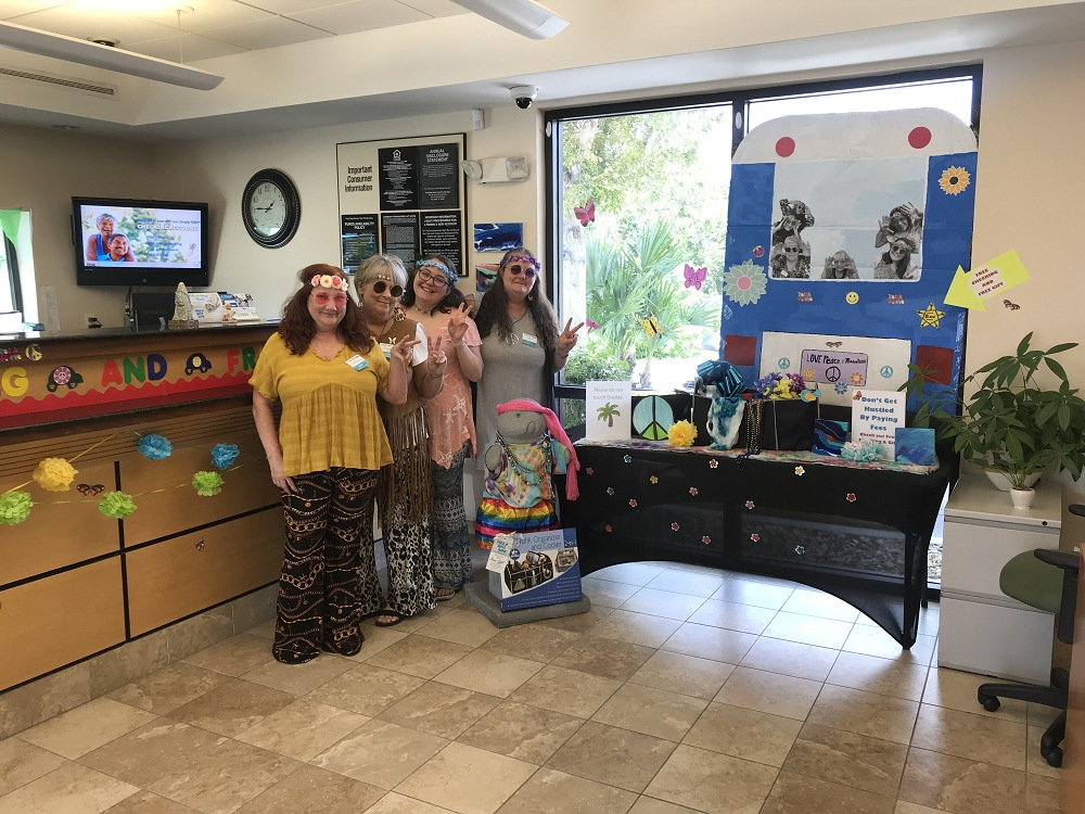 The Big Pine team showing their peace and love vibes in front of their trunk organizer display