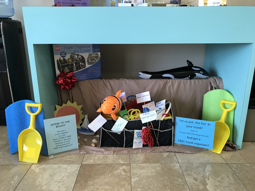 Beach theme display at our Summerland Branch featuring a trunk organizer given when opening a Free Checking Account