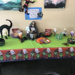 Halloween theme display featuring slow cooker giving given with opening of Free Checking account