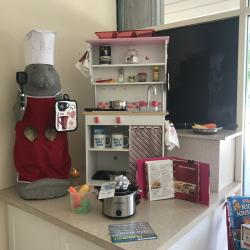 Lobby Display of a cooking scene with Bank Manatee mascot featuring the slow cooker free gift with the opening of a free checking account