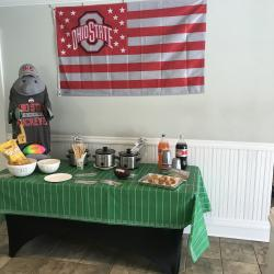 Decorated table with football theme and slow cooker we are giving away with the opening of new Free Checking account