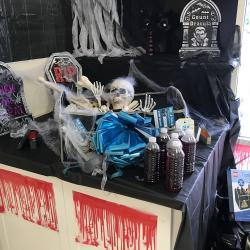 Halloween theme display at our Tradewinds Branch featuring a trunk organizer given when opening a Free Checking Account